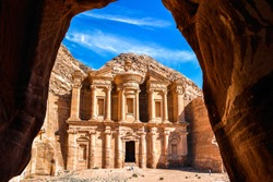 Stunning view from a cave of the Ad Deir - Monastery in the ancient city of Petra, Jordan: Incredible UNESCO World Heritage Site.
