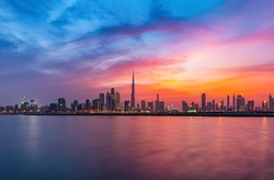 Stunning view of Dubai skyline  with warm Pastel Sunrise colors