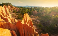 Stunning view of grand canyon steep sedimentary sandstone cliff in the primeval forest. Sao Din Na Noi, Nan Province, Thailand. Focus on the steep  sandstone cliff.