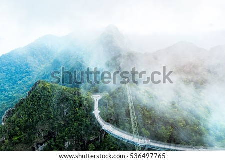 Stunning view of Langkawi sky bridge on Mat Cincang mountain. Misty clouds are above the bridge. Travel Malaysia #536497765
