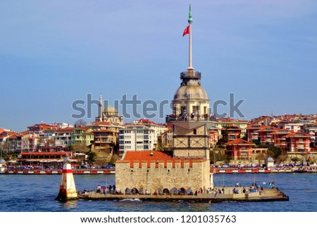 Stunning view of Maiden's Tower in Istanbul in the afternoon, with an old mosque on the Asian side of the city in the background - Istanbul, Turkey #1201035763