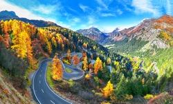 Stunning view of Maloja pass road at autumn time. Colorful autumn scene of Swiss Alps. Location: Maloya pass, Engadine region, Grisons canton, Switzerland, Europe.