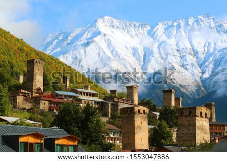 Stunning View of Medieval Svan Tower against the Snow-capped Caucasus Mountain in Mestia, Svaneti Region, Archaeological site in Georgia