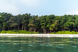 Stunning view of Radhanagar Beach on Havelock Island. Havelock Island is a beautiful small island belonging to the Indian Andaman Nicobar Islands. Paradise island in Southeast Asia.