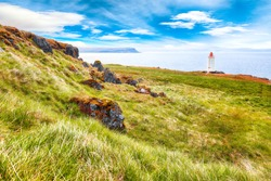 Stunning view of Skarsviti lighthouse in Vatnsnes peninsula on a clear day in North Iceland. Location: Hvammstangi, Vatnsnes Peninsula, Iceland, Europe