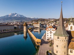Stunning view of the Lucerne old town along the Reuss river with the famous chapel's bridge in Switzerland