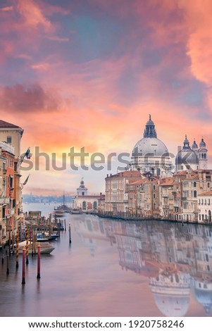 Stunning view of the Venice skyline with the Grand Canal and Basilica Santa Maria Della Salute in the distance during a dramatic sunrise. Picture taken from Ponte Dell' Accademia, Venice, Italy. ストックフォト ©