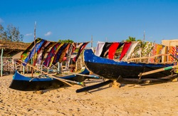 Stunning view of traditional outrigger fishermen pirogue with colorful pareo in the background, Anakao coast, Indian Ocean, Madagascar