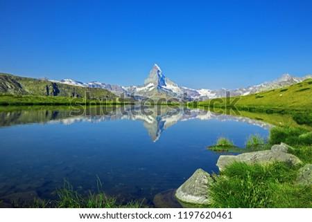 Stock Photo Stunning view on mountain Matterhorn at morning reflection in beautiful alpine lake, Stellisee, Valais region, Switzerland, Europe