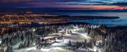 Stunning views of Vancouver City from Grouse Mountain Ski Resort at Dusk, British Columbia, Canada.