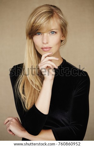 Stunning young woman in black dress, portrait Stock photo ©