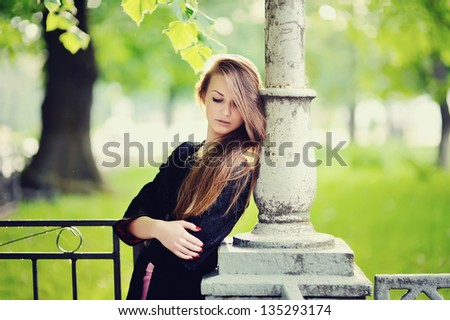 Stunning young woman portrait outside, spring