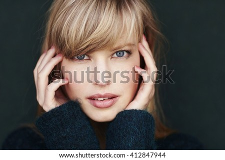 Stunning young woman with blond hair, studio Stock photo ©