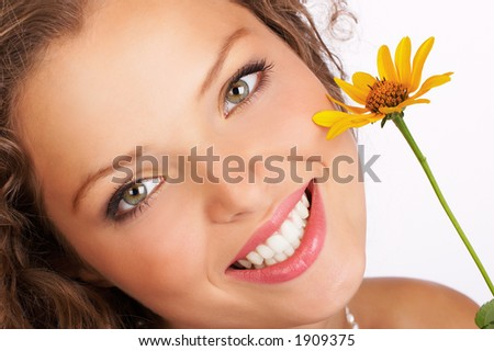 Stunning young woman with flower