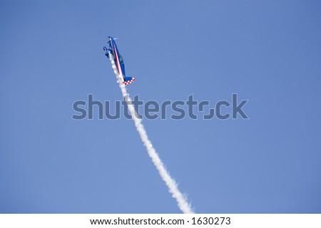 stunt plane racing up into the sky - stock photo