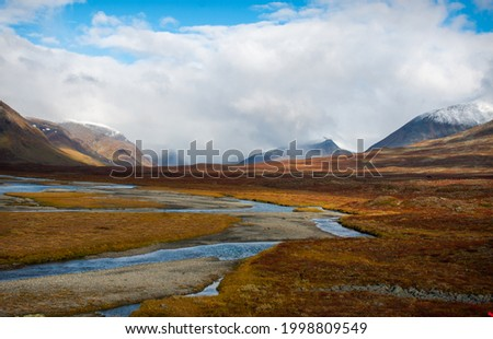 Stupendous view of a valley crossed by Kungsleden trail between Salka and Singi, Swedish Lapland, mid-September, 2020 Stock photo ©