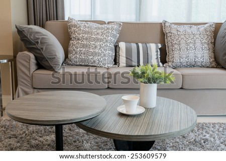 Sturdy brown tweed sofa with grey patterned pillows #253609579