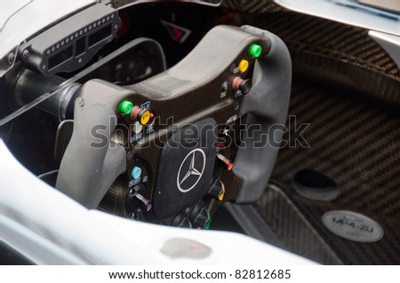 "STUTTGART - AUGUST 14 : Mercedes-Benz presenting a Formula 1 race car at event ""Sternstunden - 125 years Mercedes-Benz"" on August 14, 2011 in Stuttgart, Germany - stock photo"