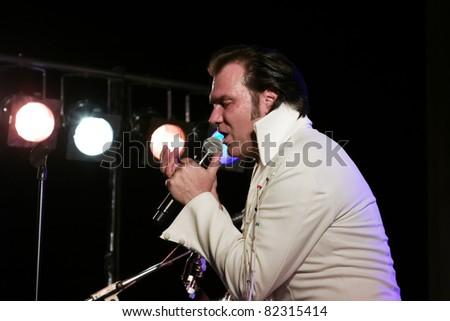 """STUTTGART - AUGUST 04: The musician and singer """"Eric Prinzinger"""" in concert at summer Festival Stuttgart August 04, 2011 in Stuttgart, Germany."""