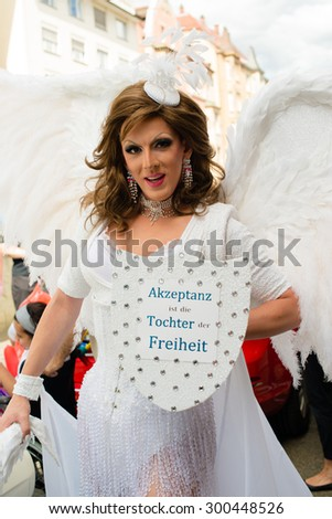 STUTTGART, GERMANY - JULY 25, 2015: A handsome man dressed as woman is presenting the motto of the Christopher Street Day 2015 in Stuttgart: Acceptance is the daughter of Liberty.