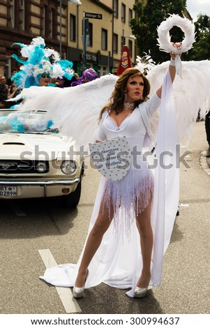 STUTTGART, GERMANY - JULY 25, 2015: A handsome man dressed as woman is presenting the motto of the Christopher Street Day 2015 in Stuttgart: Acceptance is the daughter of Liberty. The Christopher