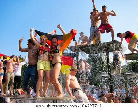 STUTTGART, GERMANY - JULY 3: German soccer fans celebrate the 4:0 victory of the German team over Argentina on July 3rd, 2010 in Stuttgart, Germany.