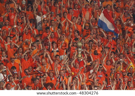 STUTTGART, GERMANY - JUNE 16:  Holland supporters celebrate the Netherlands' victory over Cote d'Ivoire in a 2006 FIFA World Cup soccer match June 16, 2006 in Stuttgart, Germany.