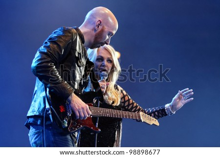 STUTTGART, GERMANY - MARCH 24: Singer Bonnie Tyler and guitarist live in concert on stage at the festival March 24, 2012 in Stuttgart, Germany