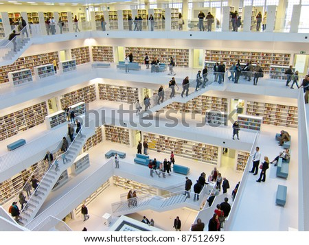 STUTTGART, GERMANY - OCTOBER 23: Book lovers visit the the new municipal public library on Oct. 23, 2011 in Stuttgart, Germany. It is designed by Eun, Young, Yi and provides more than 500.000 books. This is a view from the top level into the upper hall.
