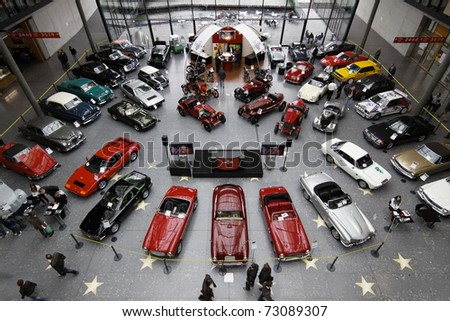 STUTTGART - MARCH 13: People buy cars - exhibition hall Retro Classics March 13, 2011 in Stuttgart, Germany.