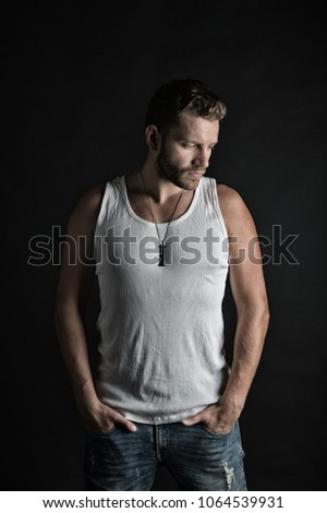 Shutterstock Style and look, barber. Fashion and beauty. Man with unshaven face in studio. Fashion model on grey background. Handsome mucho guy in vest.