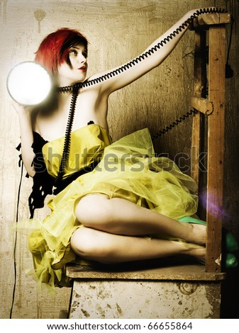 Style art photo of a sexy young woman with light