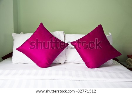 style bedroom interior with double pink  pillows on green back ground