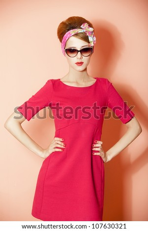 Style redhead girl at pink background.