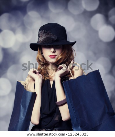Style redhead girl with shopping bags. - stock photo
