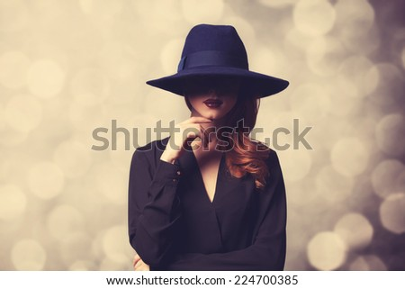 Style redhead women in black on classic background #224700385