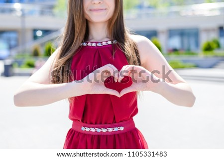 Style stylish beautiful lady vacation feelings emotions concept. Cropped close up photo portrait of fun joy joyful excited cheerful girl making heart on chest using fingers city street background #1105331483