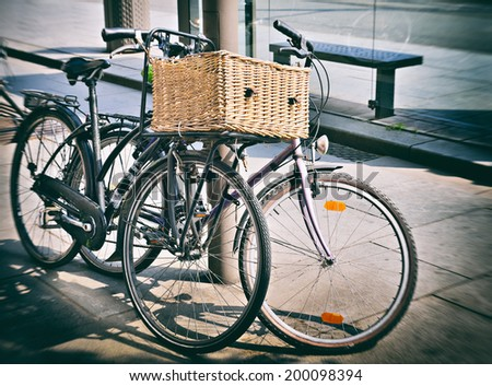 stock-photo-styled-as-old-photo-of-vintage-bicycles-parked-on-the-street-200098394.jpg
