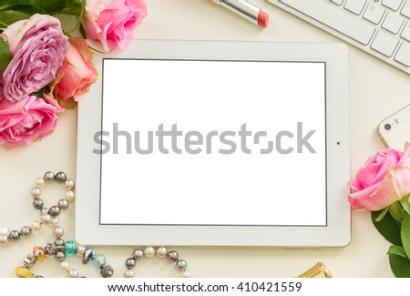 Styled desktop scene  with white tablet, mobile and pink flowers