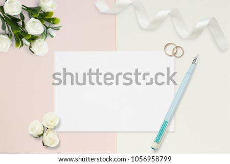 Styled stock photo. Feminine wedding desktop mockup. White roses, satin ribbon, beads on delicate beige background. Copy space. Top view. Picture for blog