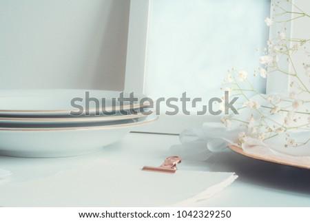 Styled stock photo. Feminine wedding desktop with baby's breath Gypsophila flowers and silk ribbon. Empty space. Image for blog.