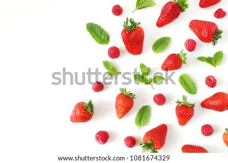 Styled stock photo. Summer healthy fruit composition with red strawberries, raspberries, fresh green mint leaves isolated on white table background. Food pattern. Empty space. Flat lay, top view.