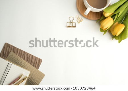 Styled stock photography white office desk table with blank notebook, keyboard, macaroon, supplies and coffee cup. Top view with copy space. Flat lay. #1050723464