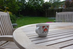 Stylised crab coffee mug on the patio table