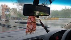 Stylised travel shot from Inside Car. Rain day shot of road from car windscreen.
