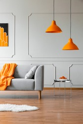 Stylish abstract paining on the wall of trendy living room interior