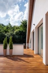 Stylish and big home terrace with wooden floor and roof decoration