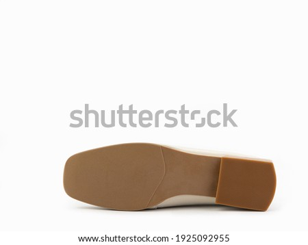Stylish and elegant ivory women's loafers. Trendy flat leather shoes with square toe and beige sole. Isolated close-up on white background. Shoe sole view. Fashion shoes. Foto d'archivio ©