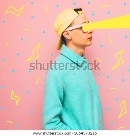 stylish and fashionable guy lets lightning out of his eyes. crazy surreal art collage