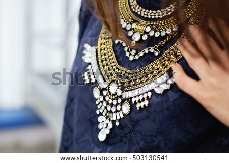 Stylish and fashionable necklace with rhinestones on chest. Street fashion element. #503130541